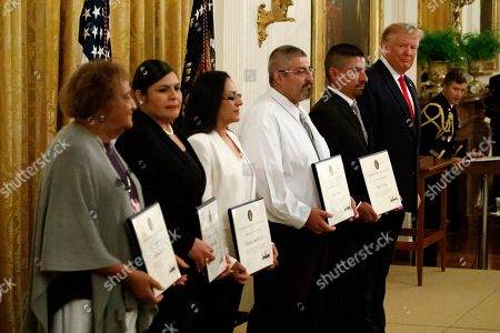 Donald Trump, Minnie Grant, Angelica Silva, Marisela Luna, Gilbert Serna, and Robert Evans. President Donald Trump, right, stands with five civilians receiving Heroic Commendations for actions during the mass shooting in El Paso, Texas, to Minnie Grant, the mother of Christopher Grant, left, Angelica Silva, Marisela Luna, Gilbert Serna, and Robert Evans, in the East Room of the White House, in Washington