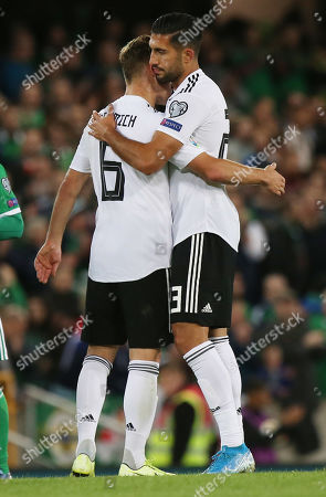 Germany's Emre Can (R) and Joshua Kimmich (L) react after the UEFA EURO 2020 qualification round match between Northern Ireland and Germany, in Belfast, Britain, 09 September 2019.