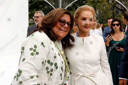 Fashion Week creator Fern Mallis, left, poses for photos with Carolina Herrera before her namesake collection is modeled, during Fashion Week, in New York