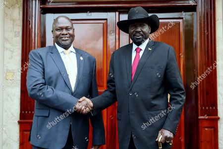 Dr. Riek Machar, left, greets South Sudan President Salva Kiir, right, on his arrival in Juba, South Sudan, Monday, Sept.9. 2019. South Sudan opposition leader Riek Machar returned on Monday to meet with President Salva Kiir and held talks in preparation for the formation of a coalition government in November