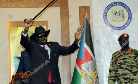 South Sudan President Salva Kiir waves to the delegates attending South Sudan Peace talks in Juba, South Sudan, Monday, Sept.9.2019. South Sudan opposition leader Riek Machar returned on Monday to meet with President Salva Kiir and held talks in preparation for the formation of a coalition government in November
