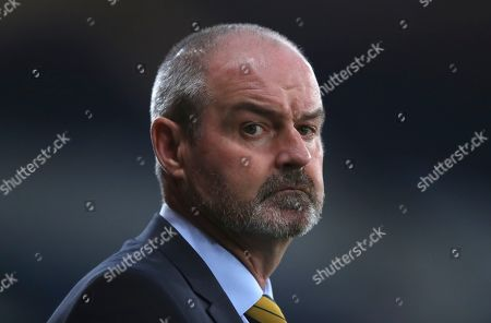 Scotland head coach Steve Clark watches from the sidelines during the Euro 2020 group I qualifying soccer match between Scotland and Belgium at Hampden Park stadium in Glasgow