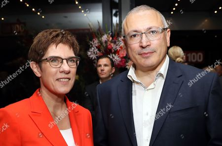 German Minister of Defense Annegret Kramp-Karrenbauer and exiled Russian businessman Mikhail Khodorkovsky attend the 'BILD100 summer party' event in Berlin, Germany, 09 September 2019. 100 of the most important decision-makers from politics and business as well as well-known personalities from sports, art and culture are expected at the event held by Germany's highest-circulation newspaper BILD.