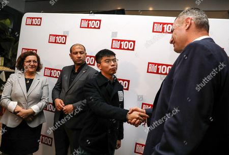 Hong Kong activist Joshua Wong (2-R) greets the Mayor of Kiev, Vitali Klitschko (R), next to the head of the Syria Civil Defense (White Helmets), Raed al-Saleh, in the 'BILD100 summer party' event in Berlin, Germany, 09 September 2019. 100 of the most important decision-makers from politics and business as well as well-known personalities from sports, art and culture are expected at the event held by Germany's highest-circulation newspaper BILD.