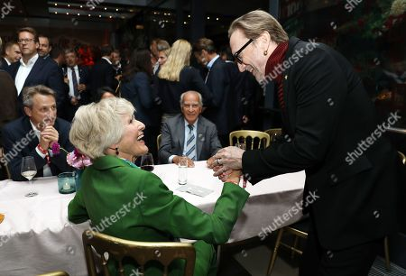 Stock Photo of German singer and actor Marius Mueller-Westernhagen (R) greets Vice-chairman of Axel Springer SE Friede Springer in the 'BILD100 summer party' event in Berlin, Germany, 09 September 2019. 100 of the most important decision-makers from politics and business as well as well-known personalities from sports, art and culture are expected at the event held by Germany's highest-circulation newspaper BILD.