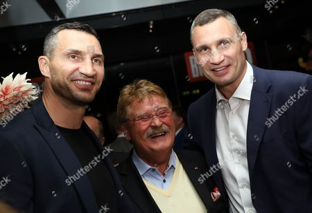 Former world heavyweight champion Wladimir Klitschko (L) and his brother the Mayor of Kiev, Vitali Klitschko (R), pose with former member of the European Parliament, Elmar Brok, in the 'BILD100 summer party' event in Berlin, Germany, 09 September 2019. 100 of the most important decision-makers from politics and business as well as well-known personalities from sports, art and culture are expected at the event held by Germany's highest-circulation newspaper BILD.