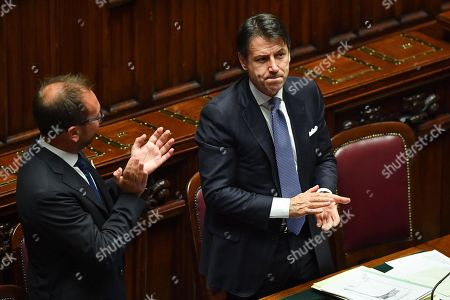 Italian Prime Minister, Giuseppe Conte (R), with the minister Alfonso Bonafede (L) celebrate after the vote of confidence to the new Government in the Chamber of Deputies, Rome, Italy, 09 September 2019. Italian Premier Giuseppe Conte presented his new government's programme in the Lower House ahead of the first of two confidence votes that the executive is set to face in parliament. His new government is a coalition between the anti-establishment 5-Star Movement (M5S) and the center-left Democratic Party (PD).