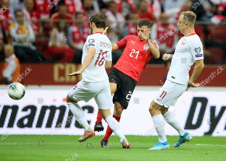 Bartosz Bereszynski (L) and Kamil Grosicki (R) of Poland and Stefan Lainer (C) of Austria in action during the UEFA EURO 2020 group G qualifying soccer match between Poland and Austria at PGE National stadium in Warsaw, Poland, 09 September 2019.
