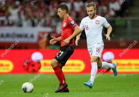 Stock Picture of Jakub Blaszczykowski (R) of Poland and Stefan Lainer (L) of Austria in action during the UEFA EURO 2020 group G qualifying soccer match between Poland and Austria at PGE National stadium in Warsaw, Poland, 09 September 2019.