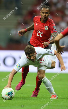 Bartosz Bereszynski (front) of Poland and Valentino Lazaro (back) of Austria in action during the UEFA EURO 2020 group G qualifying soccer match between Poland and Austria at PGE National stadium in Warsaw, Poland, 09 September 2019.