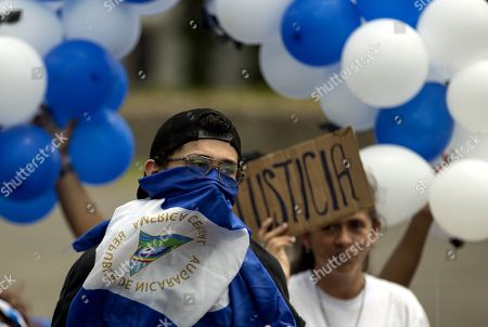 Young people participate in a protest against a budget reduction to the Central American University, in Managua, Nicaragua, 09 September 2019. Hundreds of Nicaraguan police officers were deployed in the capital Managua, before the announcement of a student protest against the Government of Daniel Ortega, for a budget reduction to the Central American University (UCA). Protests demanding the disbursement of about two million dollars that the Government has taken from the university, of almost eight million dollars from the General Budget of the Republic that correspond to it by law.
