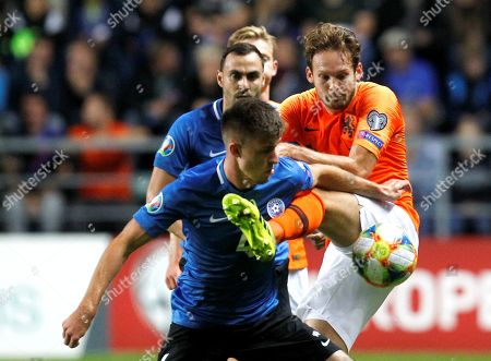 Stock Image of Netherland's Daley Blind  (R) in action against Estonia's Mattias Kait during the UEFA EURO 2020 qualifiers group C soccer match between Estonia and the Netherlands in Tallinn, Estonia, 09 September 2019.