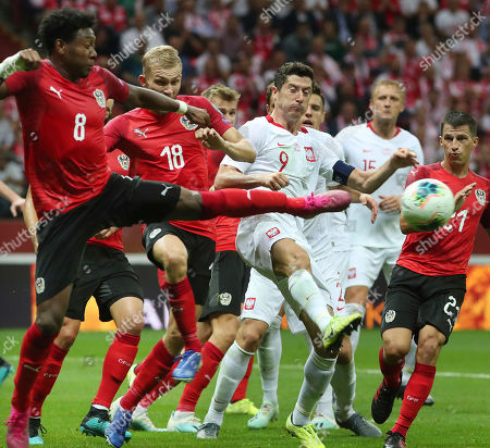 Robert Lewandowski, David Alaba. Poland's Robert Lewandowski, center, fights for the ball with the Austria's David Alaba,left, during a Euro 2020 group G qualifying soccer match between Poland and Austria at PGE National stadium in Warsaw, Poland