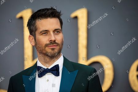 Robert James-Collier poses for photographers upon arrival at the world premiere of the film 'Downton Abbey' in London