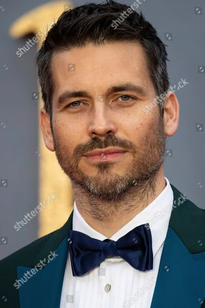 Stock Photo of Robert James-Collier poses for photographers upon arrival at the world premiere of the film 'Downton Abbey' in London