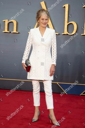 Geraldine James poses for photographers upon arrival at the world premiere of the film 'Downton Abbey' in London