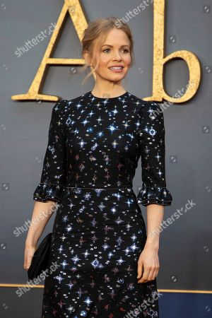 Kate Phillips poses for photographers upon arrival at the world premiere of the film 'Downton Abbey' in London