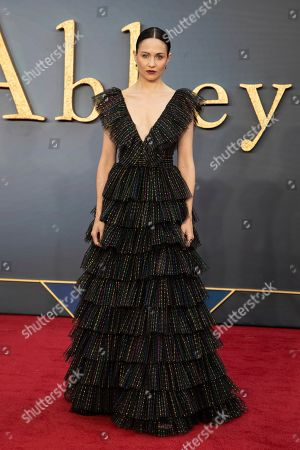 Tuppence Middleton poses for photographers upon arrival at the world premiere of the film 'Downton Abbey' in London