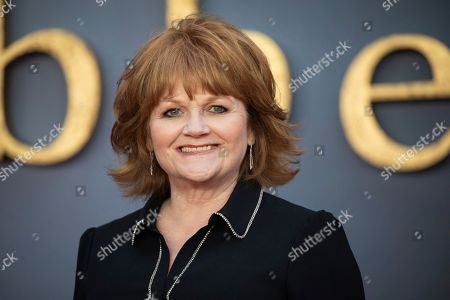 Lesley Nicol poses for photographers upon arrival at the world premiere of the film 'Downton Abbey' in London