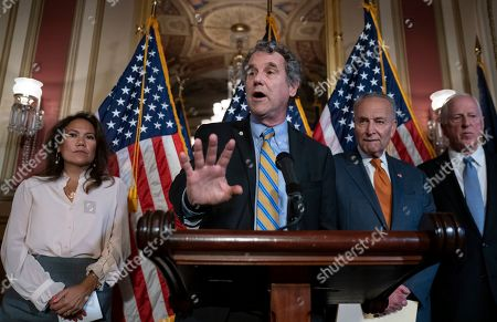 Chuck Schumer, Veronica Escobar, Mike Thompson, Sherrod Brown. From left, Rep. Veronica Escobar, D-Texas, whose district contains El Paso, Texas, where a gunman killed 22 people at an El Paso, Texas, Walmart store, Sen. Sherrod Brown, D-Ohio, Senate Minority Leader Chuck Schumer, D-N.Y., and Rep. Mike Thompson, D-Calif., chairman of the House Gun Violence Prevention Task Force, call for a Senate vote on the House-passed Bipartisan Background Checks Act as Congress returns for the fall session with pressure mounting on Senate Majority Leader Mitch McConnell to address gun violence, at the Capitol in Washington