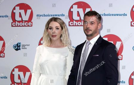 Katherine Ryan and her partner Bobby Kootstra pose for photographers on arrival at the TV Choice Awards in central London on