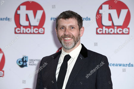 Stock Photo of DAve Gorman poses for photographers on arrival at the TV Choice Awards in central London on