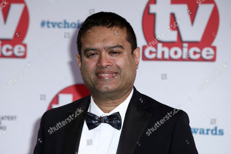 Paul Sinha poses for photographers on arrival at the TV Choice Awards in central London on