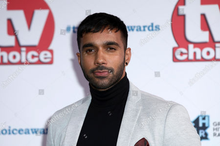 Rishi Nair poses for photographers on arrival at the TV Choice Awards in central London on