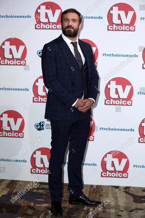 Jamie Lomas poses for photographers on arrival at the TV Choice Awards in central London on