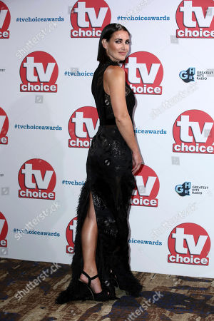 Kirsty Gallacher poses for photographers on arrival at the TV Choice Awards in central London on