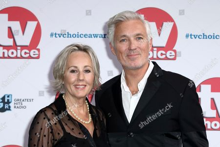 Stock Image of Martin Kemp and his partner Shirlie Kemp pose for photographers on arrival at the TV Choice Awards in central London on