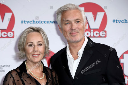 Martin Kemp and his partner Shirlie Kemp pose for photographers on arrival at the TV Choice Awards in central London on