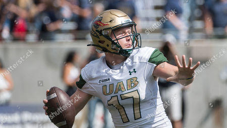 University of Alabama at Birmingham quarterback Tyler Johnston unloads a 76-yard touchdown pass against the University of Akron during an NCAA football game on in Akron, Ohio