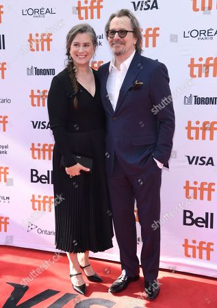"Gary Oldman, Gisele Schmidt. Gary Oldman, right, and Gisele Schmidt attend a premiere for ""The Laundromat"" on day five of the Toronto International Film Festival at Princess of Wales Theatre, in Toronto"