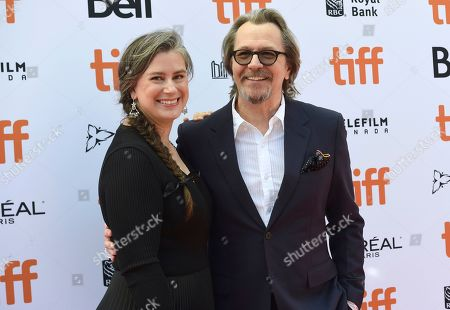 "Stock Image of Gary Oldman, Gisele Schmidt. Gary Oldman, right, and Gisele Schmidt attend a premiere for ""The Laundromat"" on day five of the Toronto International Film Festival at Princess of Wales Theatre, in Toronto"