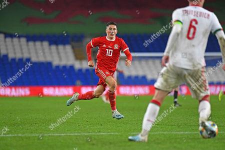 Harry Wildson of Wales marks the Belarus Captain Sergei Politevich in the second half.
