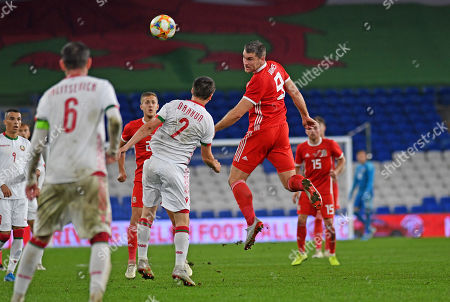 Sam Vokes of Wales heads the ball late in the second half.