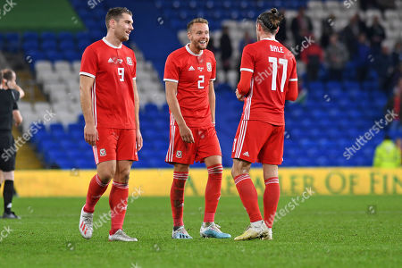 Sam Vokes, Chris Gunter and Gareth Bale of Wales celebrate at the final whistle.