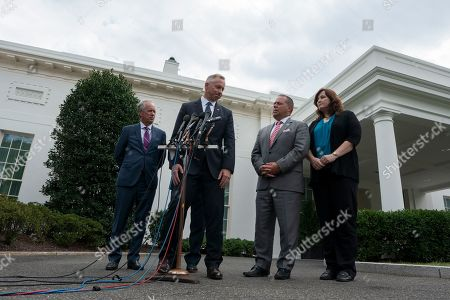 Stock Picture of From left to right: Mayor Greg Fischer of Louisville, KY, Mayor John Giles of Mesa, AZ, Mayor Bryan Barnett of Rochester Hills, MI, and Mayor Christine Hunschofsky of Parkland, FL speak to the press outside the White House