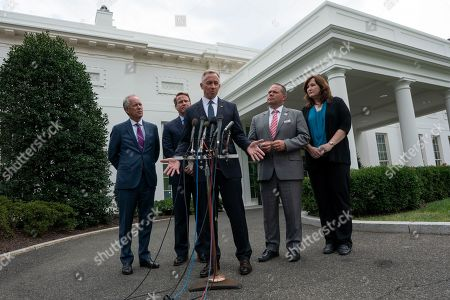 Stock Image of From left to right: Mayor Greg Fischer of Louisville, KY, Ohio Lt. Governor Jon Husted, Mayor John Giles of Mesa, AZ, Mayor Bryan Barnett of Rochester Hills, MI, and Mayor Christine Hunschofsky of Parkland, FL speak to the press outside the White House