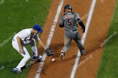 Seth Lugo, Eduardo Escobar. New York Mets' relief pitcher Seth Lugo, left, retrieves a rolling foul ball by Arizona Diamondbacks' Eduardo Escobar, right, who runs to first base during the ninth inning of a baseball game, in New York