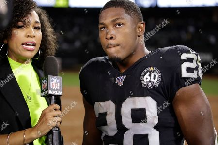 NFL reporter MJ Acosta interviews Oakland Raiders running back Josh Jacobs at the end of an NFL football game against the Denver Broncos, in Oakland, Calif. Oakland won the game 24-16