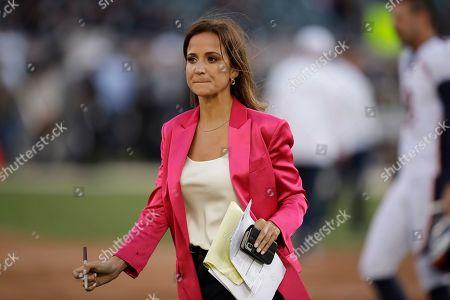 Stock Picture of ESPN reporter Dianna Russini on the sidelines before the start of an NFL football game between the Oakland Raiders and the Denver Broncos, in Oakland, Calif
