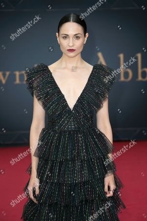Tuppence Middleton poses for photographers upon arrival at the World premiere of the film 'Downton Abbey' in central London