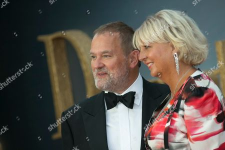 Hugh Bonneville, Lulu Evans. Hugh Bonneville, left and wife Lulu Evans pose for photographers upon arrival at the World premiere of the film 'Downton Abbey' in central London