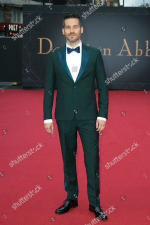 Robert James-Collier poses for photographers upon arrival at the World premiere of the film 'Downton Abbey' in central London