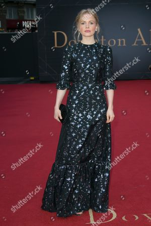 Kate Phillips poses for photographers upon arrival at the World premiere of the film 'Downton Abbey' in central London