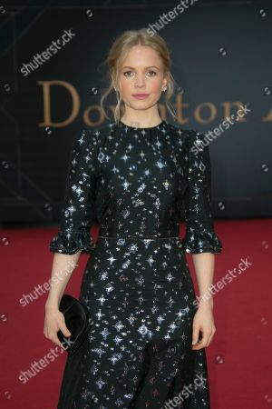 Stock Photo of Kate Phillips poses for photographers upon arrival at the World premiere of the film 'Downton Abbey' in central London