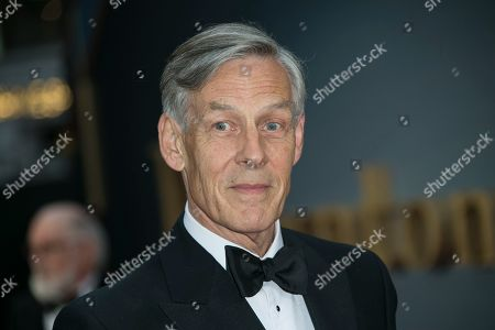 Douglas Reith poses for photographers upon arrival at the World premiere of the film 'Downton Abbey' in central London