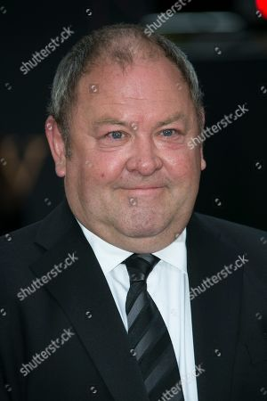 Mark Addy poses for photographers upon arrival at the World premiere of the film 'Downton Abbey' in central London